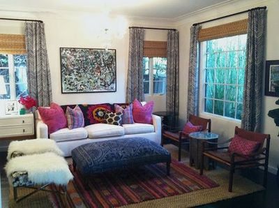 Boho living room. Great jewel tones, layered rugs, lots of t ...