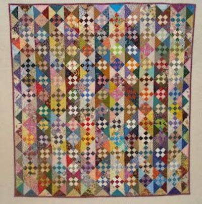 "3"" nine patch alternating with light and dark HST-ok, it is your average quilt but nice easy scrappy pattern."