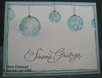 Great way to use simple circle punches to make a Xmas card.