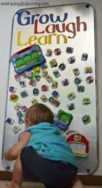 Magnetic Fun Board. All you need is an oil drip pan from Wal Mart and some Vinyl stickers!