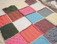 quilted look, but with knitted squares. Some patterns knit individual squares and sew them together on a machine, others you join them via knitting or crocheting, and some changing colors at every square.