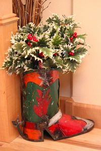 Filled a metal western boot with holly filler for an inviting entry way decoration