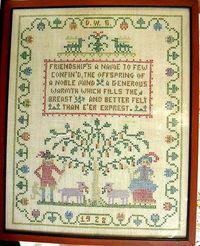 Vintage framed cross stitch sampler with Friendship verse