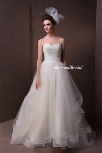 custom tulle layered A-line wedding gown