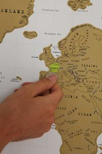Scratch off world map - only $34 from Urban Outfitters. So going in our new house :)