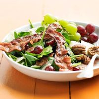Spinach and bacon salad with grapes, dilled havarti cheese and a bacon-raspberry vinaigrette
