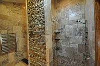 Rock wall makes a statement in front of the shower.