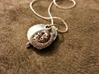 Fish charm necklace on a silver plated chain