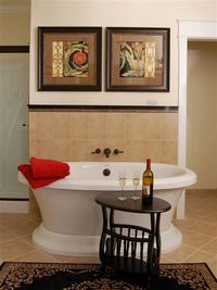 At the Bed & Breakfast on Tiffany Hill: The Charlottesville Suite's private bath includes an air jet free-standing tub, separate shower and his & her vanities.