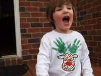 http://www.thechirpingmoms.com, Holiday Gift Ideas: Personalized DIY Handprint Rudolph the Reindeer Glowing Shirt at Messy Kids Designs.