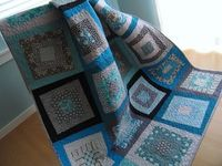 Blue quilt on chair Oh Frannson
