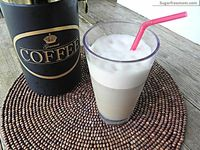 coffee frappe in blender w/ almond milk + vanilla + ice