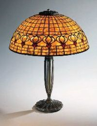 A DICHROIC 'POMEGRANATE' LEADED GLASS AND BRONZE TABLE LAMP