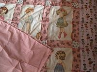 Paper doll quilt. The fabrics are from Windham/Paper Dolls by Sheryl Rae Marquez