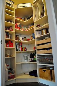 Pantry Makeover- love the slide out drawers & separated dividers for cookie sheets & such