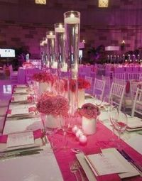 The tall vases with floating candles is gorgeous!