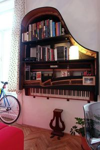 Recycled old broken piano = fabulous bookcase