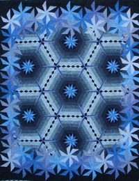 "Blue ... The border of the quilt is ""Pinwheel Spin"" and the interior part of the quilt is a diamond chain pattern. My quilt place"
