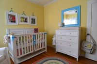 Love the big prints above the crib and bright mirror above changing table