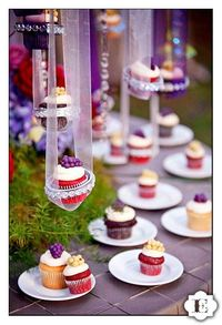 Hanging cupcakes�€�. charming idea for a wedding dessert table.