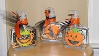 Simple hand sanitizer + cricut halloween shapes + modge podge + ribbon + diamond accent stickers ='s BOO Germs Be Gone.