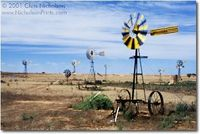 This is an Art Print by Chris Nicholson. The Outback town of Penong needs all the help it can get to bring water to its residents. Thus the dozens of windmills at the town's edge, which pump water from the Anjutabie water basin under the desert.
