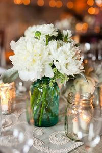 Mason jars candles and flowers