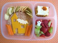 Spooky Haunted House Bento! Cream cheese & jelly sandwich, made with Santa Cruz Organic Blackberry-Pomegranate Jam and Nature's Own Whole Wheat Sandwich Rounds. The bread is such a nice blank canvas that I just had to decorate it. We have an orang...