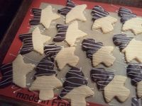 Sugar cookies, dipped in ghirardelli with a white chocolate drizzle.
