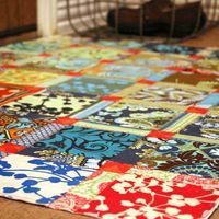 Floor mat made with fabric scraps and modge podge...interesting.