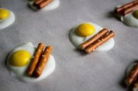 bacon and egg candies- white chocolate, yellow M, and a pretzel stick by lillie
