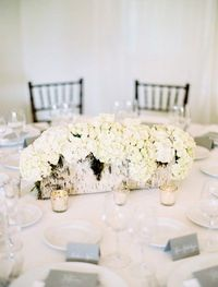 Use a birch log for a white or winter wedding or use driftwood or regular logs for another style.