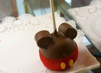 A lone Mickey Mouse candy apple at the Main St Confectioners...