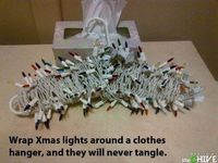 organize Christmas lights by wrapping around a clothes hanger