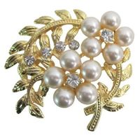 Artistically Designed Gold Pearls Flower Bouquet brooch for sashes or all purpose decorated with cubic zircon stud pefect for all dresses brooch with beautiful craftmanship at affordable price your budget price very beautiful decorate & for all occass...