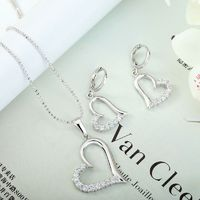 Heart Necklace Earring Set This silver heart jewellery set features floating heart design half paved with prong set rhinestones.The heart necklace earrings set is crafted in Rhodium plated over alloy with a silver bead chain and lever back clasps.
