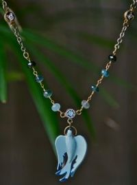 a beautiful blue bird pendant