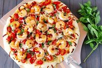Shrimp Fra Diavolo Pizza. Simply stated...this sounds refreshingly delicious. Shrimp, tomatoes, red pepper flakes, dry white wine and the list goes on and on. Yum.