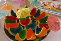 Pour jello shoots into half an orange then once their done, cut them!! Umm